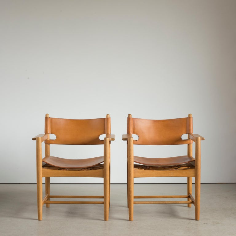 Børge Mogensen two armchairs of oak and natural leather. Executed by Fredericia Furniture.