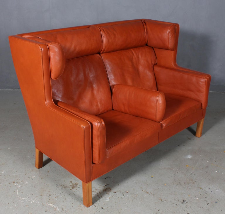 Børge Mogensen two-seat kupé sofa with original cognac / Tan leather upholstery.  Legs of mahogany.  Model 2192, made by Fredericia Furniture.