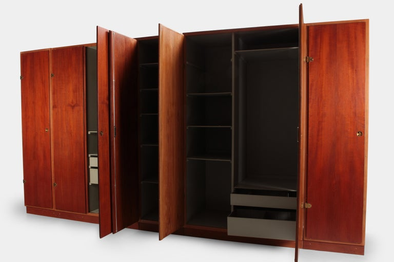 Børge Mogensen wardrobe manufactured by Karl Andersson & Söner in the 1960s in Denmark. Very generous wardrobe with several shelves, drawers and hanging mounts. The fronts are veneered with teak wood and have details made of solid brass. The inside