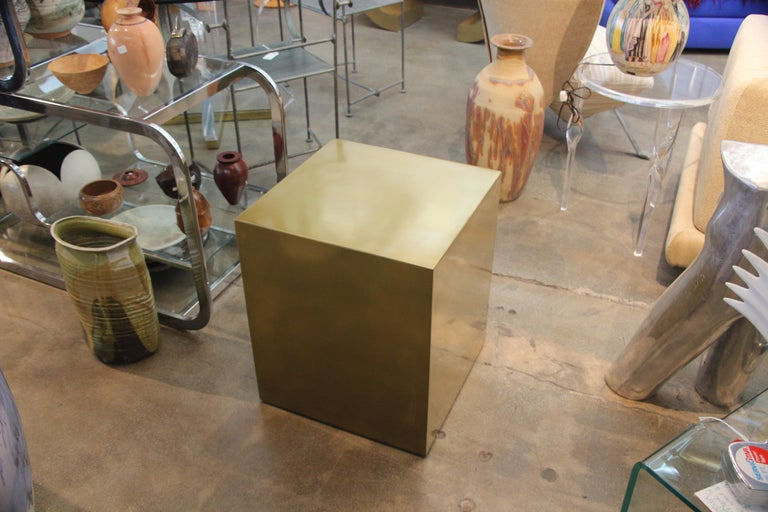 A bridges over time originals brass coated cube table designed by MarCo Antonio. It is a handmade prototype but can be ordered in any color and size. Some minor imperfections as it is a prototype and handmade. A mate can be made to order.