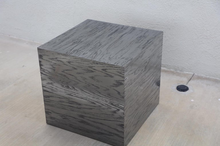 A bridges over time originals designed by Marco Antonio. It made of oak and then coated in stainless steel. The piece is then cerused, creating a unique look. This table can be produced in any size and different color finishes. This is a prototype