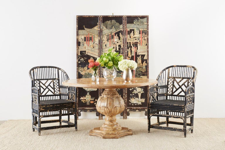 Fantastic set of four bamboo rattan lacquered armchairs made in the Brighton Pavilion Chinese Chippendale taste. Featuring a lovely distressed black lacquer finish. Each chair has a rattan frame decorated with geometric designs and a wood framed