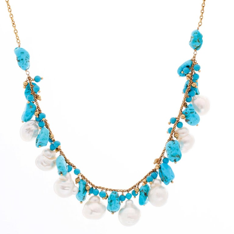 Turquoise and Baroque Pearls 14K Yellow Gold Necklace - Beautiful yellow gold necklace with 8 unique dangling baroque pearls separated by turquoise stones. Necklace measures 16 inches. Pre-owned with box. .