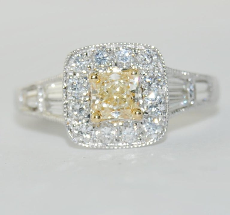 Ladies 0.47 Carat Emerald Cut Fancy/Yellow Center Diamond Ring surrounded by 0.80 Carat Brilliant Baguettes and Round White Diamonds.  This new ring is made of 18 Karat White Gold.  Size 6.5