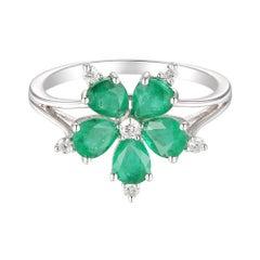 Brilliant 14 Karat White Gold, Diamond, and Emerald Flower Ring