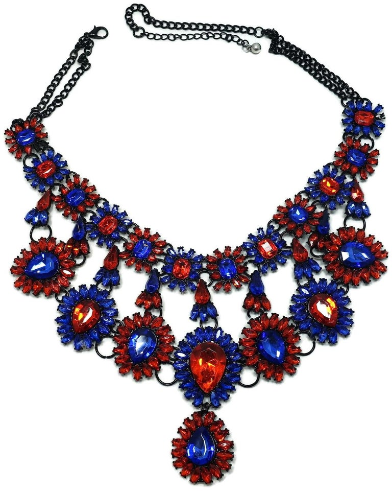 """This stunning bib necklace features brilliant blue and orange color crystals in a Japanned setting.  In excellent condition, this necklace measures 24"""" with a spring closure; the center drop is 4-1/2"""" top to bottom."""