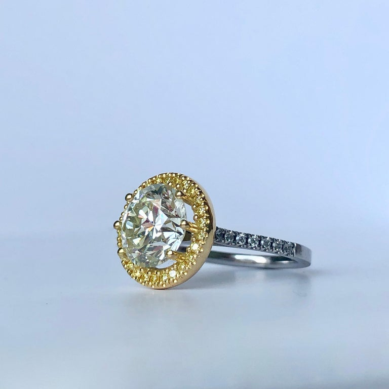 Round Cut Diamond In Fancy Yellow Diamond Halo  Bi Colour 18k Gold   Total Carat Weight 4.10ct   Principal Diamond 3.80ct M/N colour - VS Clarity  A very clean and lively diamond  available any ring size  Videos available   This is a diamond from a