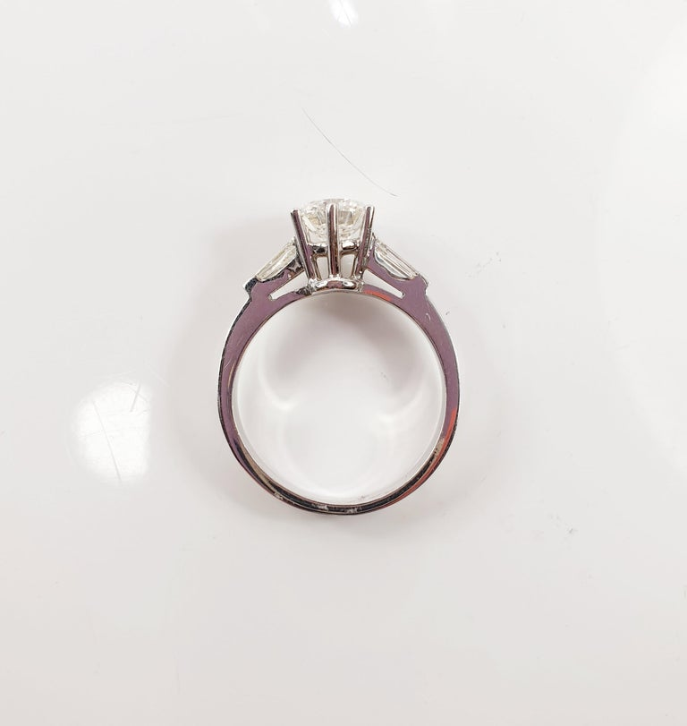 Very unique statement  piece, very sober mounting, discrete and elegant for every day wearable look.... Brilliant Diamond Soliaitre Ring 1,29Ct with side tapered baguettes 0,32c in 18K White GoldREADY TO SHIP  *Resizing may be possible. Send us a