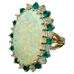 Brilliant Fire 9.6 Carat Oval Opal Diamond and Emerald Halo Two-Tone Gold Ring