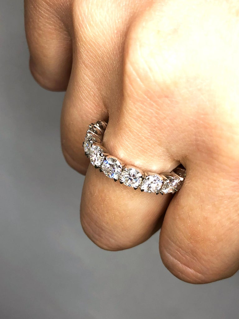 Diamond Eternity Band set in Platinum. Round Brilliant diamonds are F-G VS2-SI1 . Carat weight = 4.45ct. Total ring weight 7.12 grams.  Ring size 5. Can be sized upon request. This ring is customizable, price may vary depending on modifications such