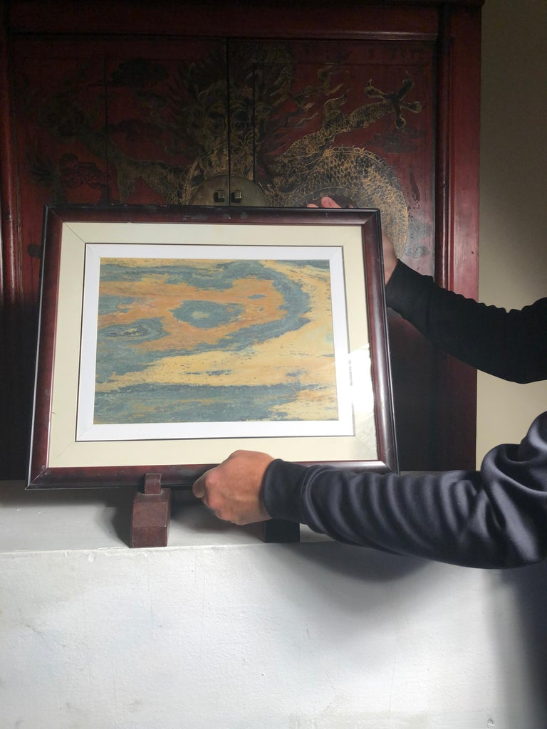 Extraordinary natural work, one of a kind. Custom framed  This Chinese extraordinary round natural stone painting of a possible brilliant swirl or scene could remind us of a unique experience and view in our lives. The powerful and colorful