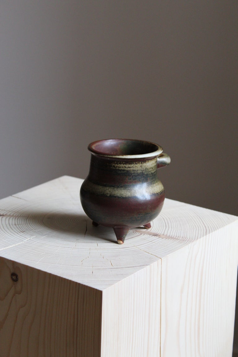 A vase / vessel produced by Arabia, Finland, 1950s. Designed and signed by Brita Heilimo.  Has a similar style as works by ceramicists such as Axel Salto, Carl-Harry Stålhane, Wilhelm Kåge, or Arne Bang.
