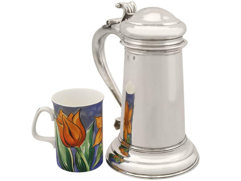 An exceptional, fine and impressive antique Queen Anne English Britannia standard silver tankard; an addition to our range of collectable 18th century silverware  This exceptional antique Queen Anne Britannia standard silver tankard has a plain