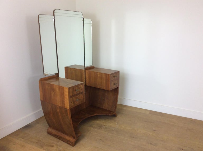 Art Deco bedroom set, with double wardrobe, linen press and dressing table. All in a stunning figured walnut with skyscraper front. Art Deco linen press. 119 cm H 76 cm w 48.5 cm D Art Deco dressing table with full length mirror. 158 cm H 107 cm