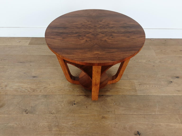 Art Deco table. Art Deco 3-tier occasional table in a brown burr walnut. Measures: 51 cm height, 60.5 cm diameter, 27 cm high to the centre shelf. British, circa 1930.