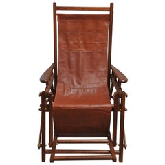 British Campaign Folding Teak and Leather Safari Chair and Recliner, Early 1900s