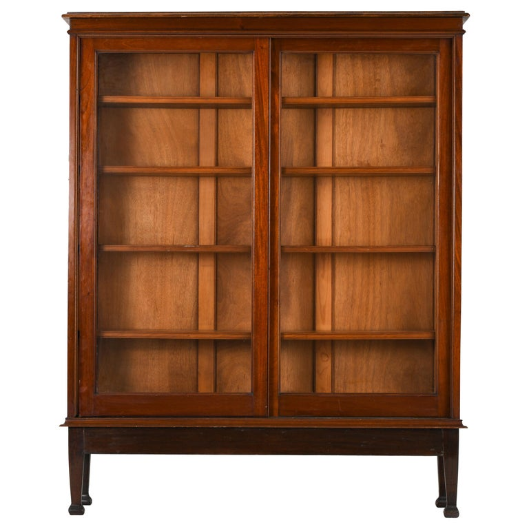 British Colonial Bookcase Sliding Teak Doors, 1950s For Sale