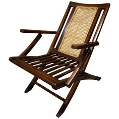 British Colonial Folding Campaign Chair with Cane Work and Bolts