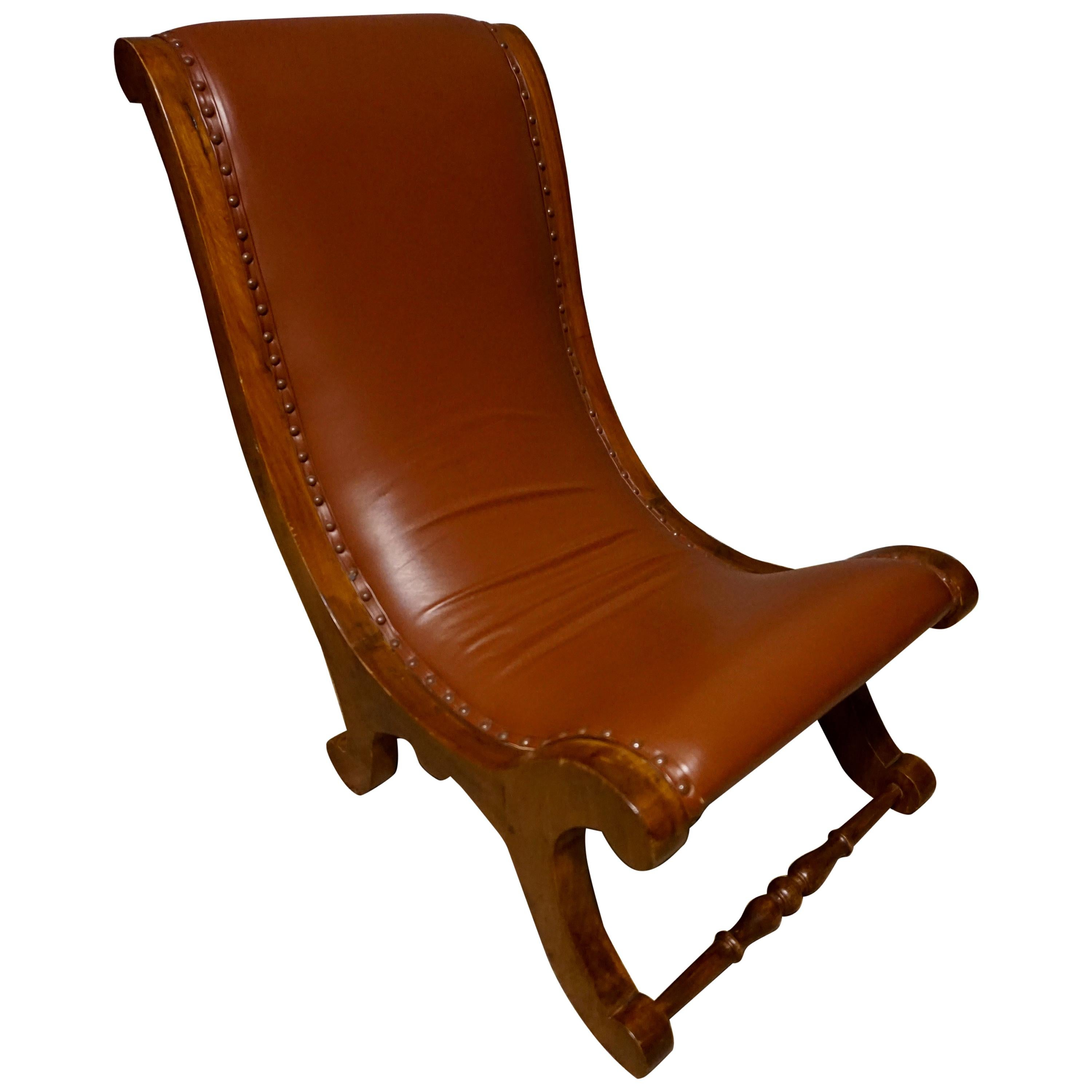 British Colonial Teak Slipper Chair With Leather Upholstery
