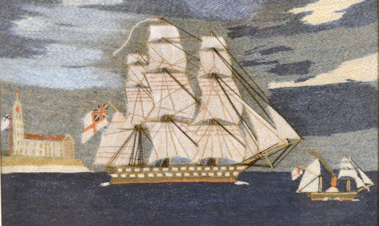 British Sailor's Woolwork or woolie of Two Royal Navy Ships including a Paddle ship, circa 1875    The sailor's woolwork, known as woolie, depicts a starboard-side view of two Royal Navy Ships leaving land on a flat blue sea. As they sail and