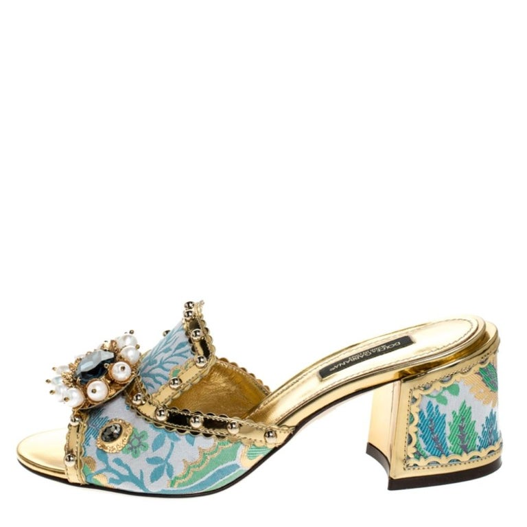 Flaunt these fabulous sandals from Dolce & Gabbana and step out in style. These sandals will make you look confident and stylish. Crafted from luxurious brocade fabric and patent leather, they come in striking multicolored hues. The uppers are