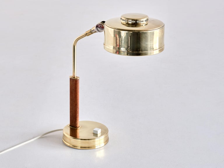 This striking desk or table lamp was produced by the Bröderna Johansson company in Skellefteå, Sweden in the late 1950s. The company was founded by the brothers Gustaf and Verner Johansson in 1946. This model was numbered 51 /M and is made of a