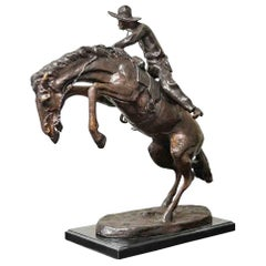 Bronco Buster Bronze Sculpture on Marble Base, after Frederic Remington