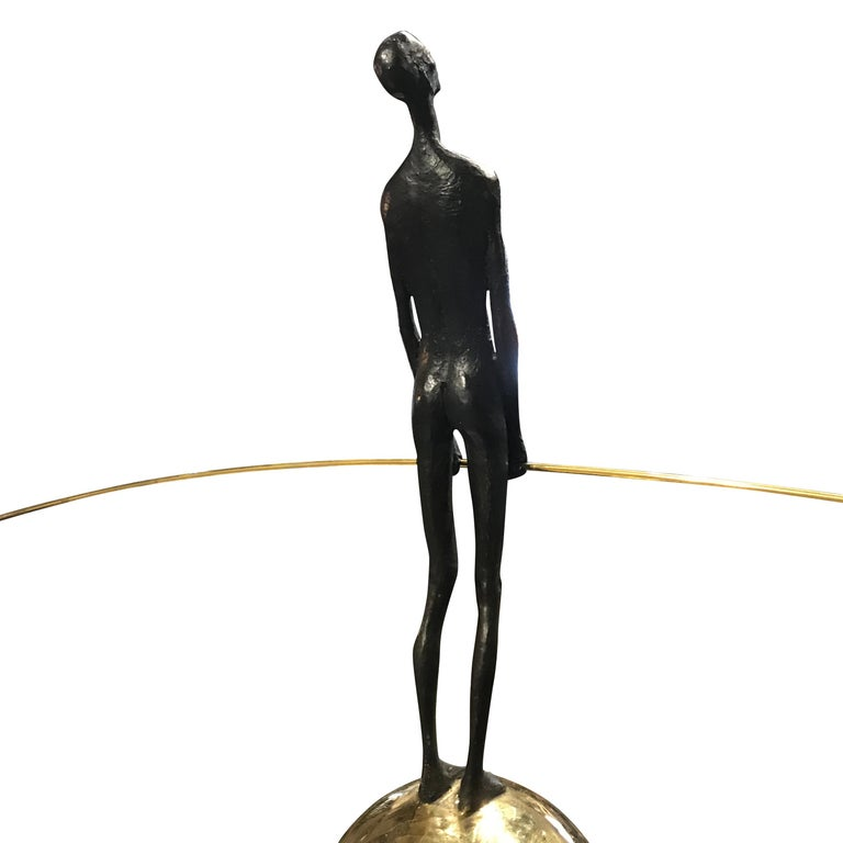 Contemporary German bronze acrobat standing on bronze ball mounted on wood pedestal