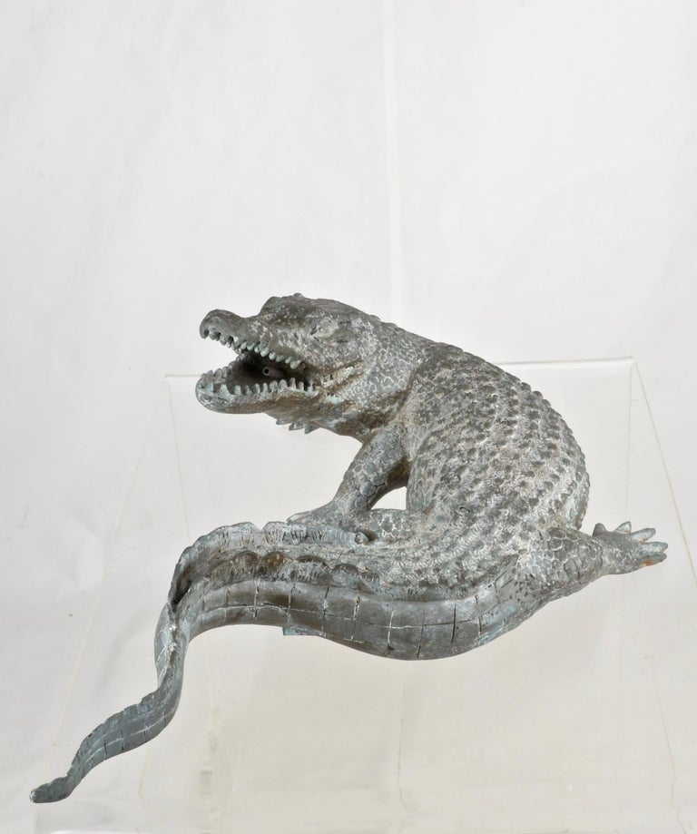 A whimsical water feature in a finely crafted alligator form. Intake under the tail and output in open mouth. Perfect patina. Nice size and that face!