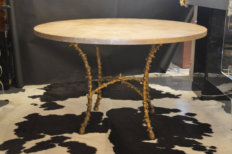 Center table with metallic faux shagreen top and solid bronze legs. In the style of Maison Bagues