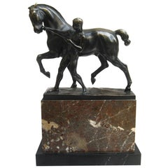 Bronze and Marble Sculpture of a Man Pulling the Reigns of a Horse