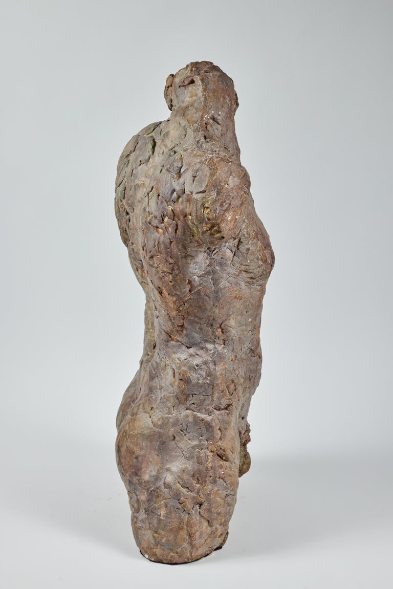 Striking male nude sculpture executed in bronze with plaster. Unsigned. On pedestal.