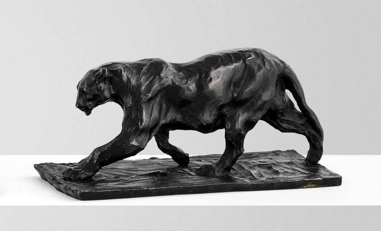 Impressive Bugatti inspired solid dark brown patinated bronze depicts a standing jaguar on a rectangular naturalistic base.  Superb modeling if this exceptional Art Deco inspired piece captures strength and power of this majestic big cat.