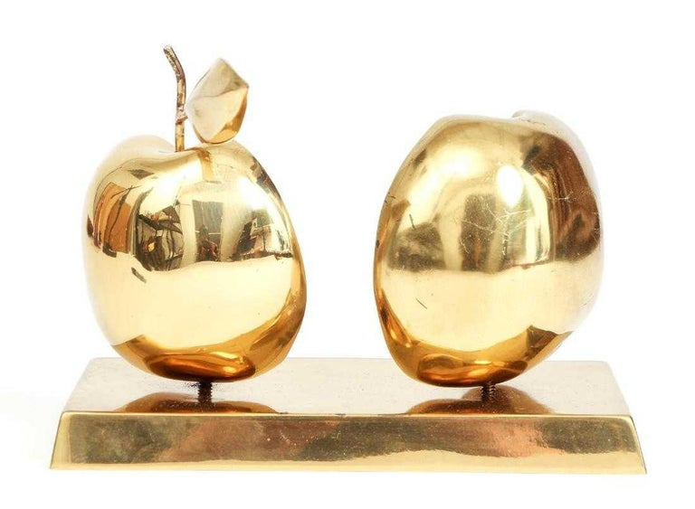 David Meshulam (Israeli Bulgarian 1930-1987) original bronze halved apple sculpture, including base stand with inscribed signature and date (1977) numbered 7/8. Base is shaped like a bar of gold bullion. The apple halves are removable via screws