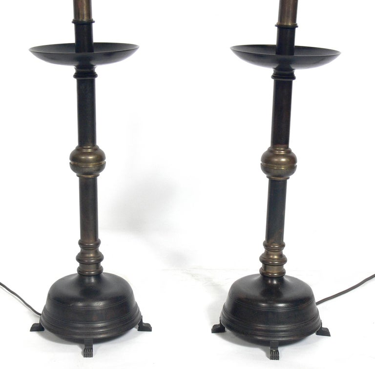 Bronze Asian style lamps, circa 1950s. They retain their wonderful original patina to the bronze. They have been rewired and are ready to use. The price noted below includes the shades.