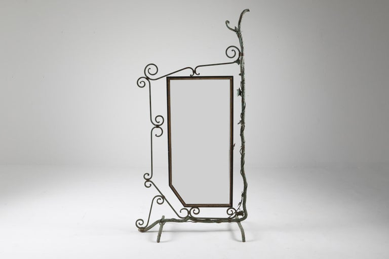 French mirror displaying a scenery of vines and leafs of grapes