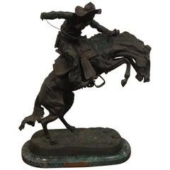 Bronze  Remington Titled 'Bronco Buster'