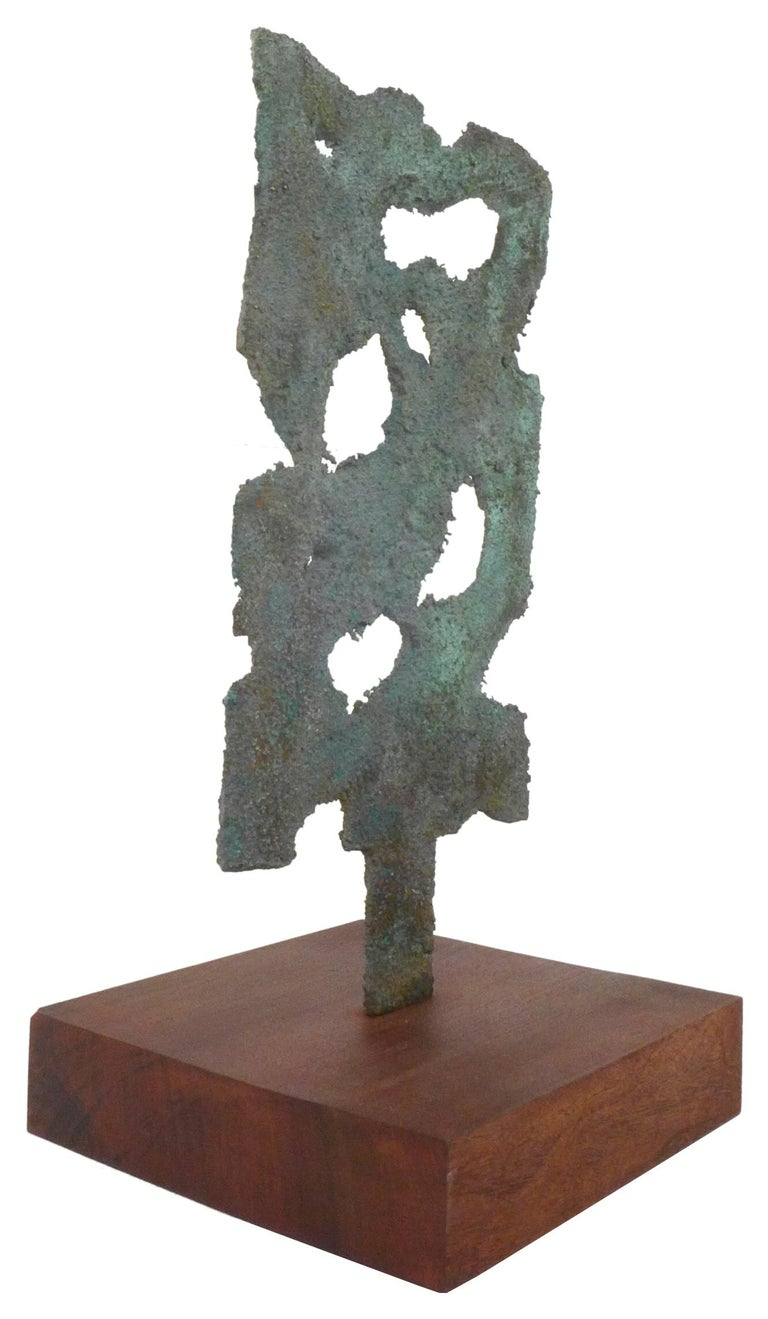 A wonderfully executed, abstract bronze sculpture, very much in the manner of Harry Bertoia. Artfully composed with organically inspired open-work, with a spectacular verdigris patina. Mounted on original, artist-made wood base and presentable from