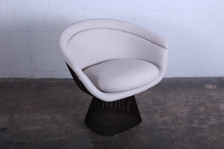 A bronze armchair designed by Warren Platner for Knoll. Newly upholstered. Nice patina to frame.