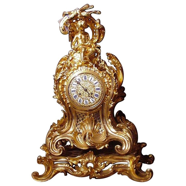 Bronze clock featuring enameled plaques with Roman numerals For Sale