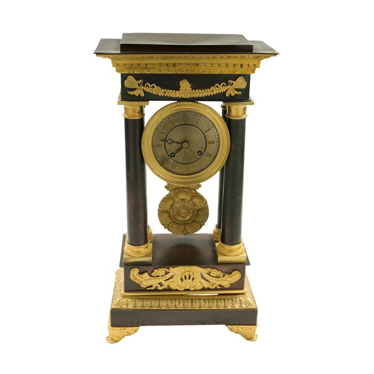 French Restauration Period  Patinated and Gilt Bronze Clock