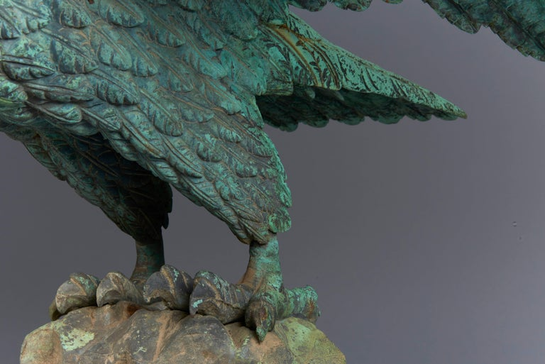 A finely carved eagle cast in bronze with an all over great patina. Manufactured in the 1880s, the golden age of American architectural and garden ornament when companies like F.W. Fiske, Mott and others in the northeast and midwest flourished,