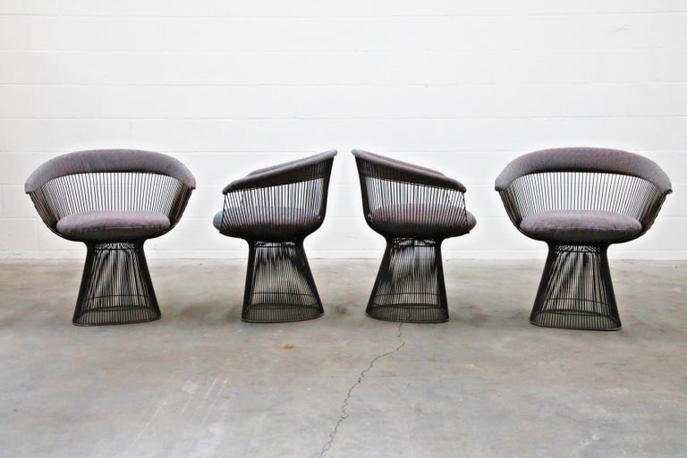 What sets this set of four (4) Warren Platner for Knoll International dining armchairs apart from others is that they are early production original solid bronze examples which are no longer in production (this set produced between 1968 and 1970) ,