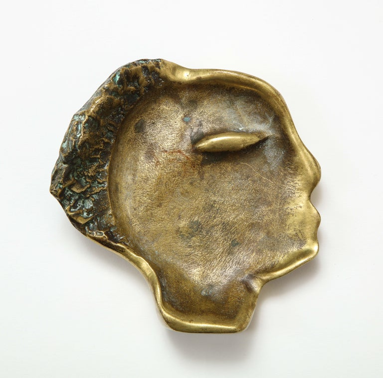 Bronze videpoche in the shape of a face, France, circa 1960.