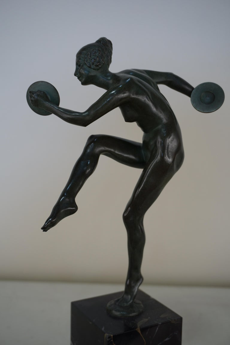 French bronze Art Deco nude with cymbals dancer with balanced on the toes of one foot.