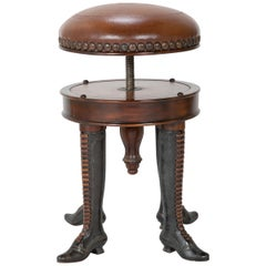 Bronze Four Legged Adjustable Revolving Stool with Leather Upholstered Seat