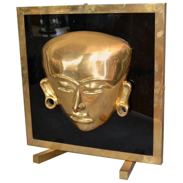 Bronze Framed Brass African Mask on Black Glass Table Art For Sale