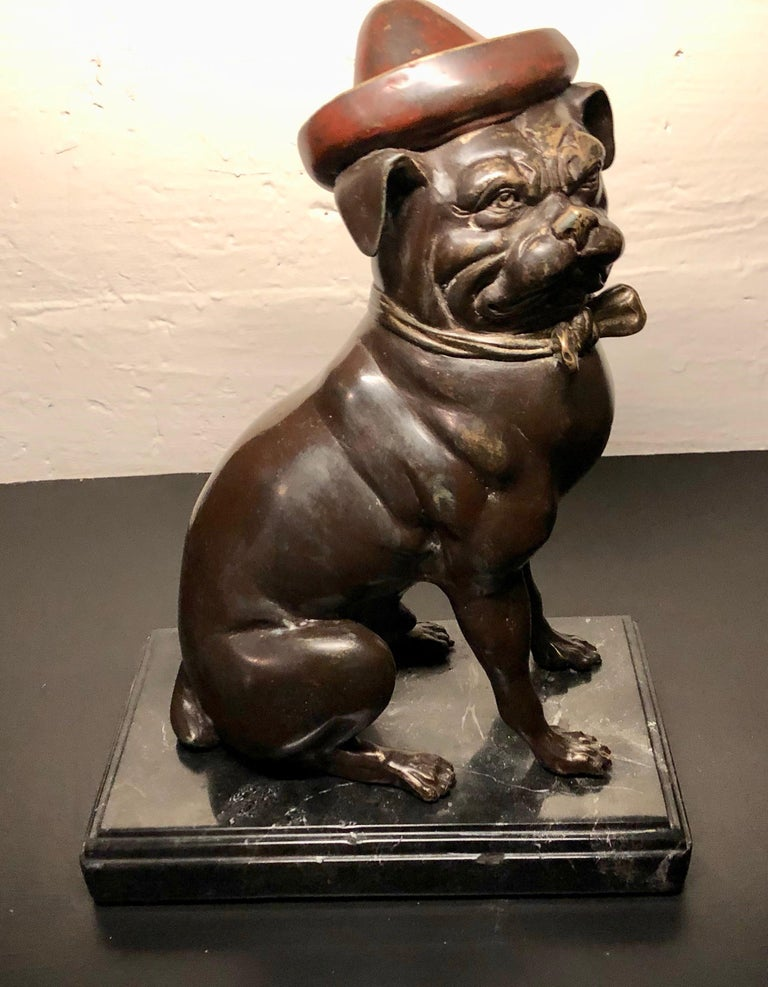 French Bulldog sculpture in bronze with cold painted enamel color. Caricatures are often seen of these unusual and highly collected dogs. This one sports a hat and bow tie. They find favour in the homes of so many animal lovers. I fell in love with