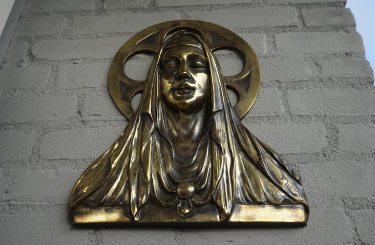 Unique antique bronze wall plaque by Belgian sculptor Sylvain Norga.  This Gothic Revival work of religious art dates from the Art Deco era and it is a little bit of a rare specimen. For some reason, Sylvain Norga almost always created bronze wall