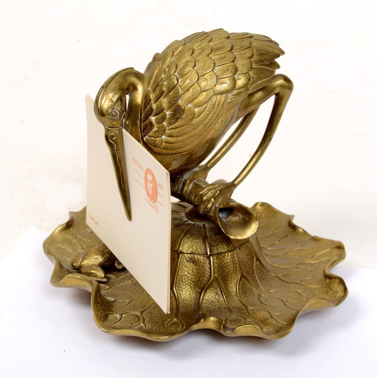 Bronze Heron & Frog Lily form inkwell, with an articulated hinged mouth letter holder. The heron perched on an open branch swivels to reveal an ink pot. The lily pad base pen holder with a seated frog, no visible markings. This form was seen in the